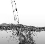 photo of pouring stream of clear water